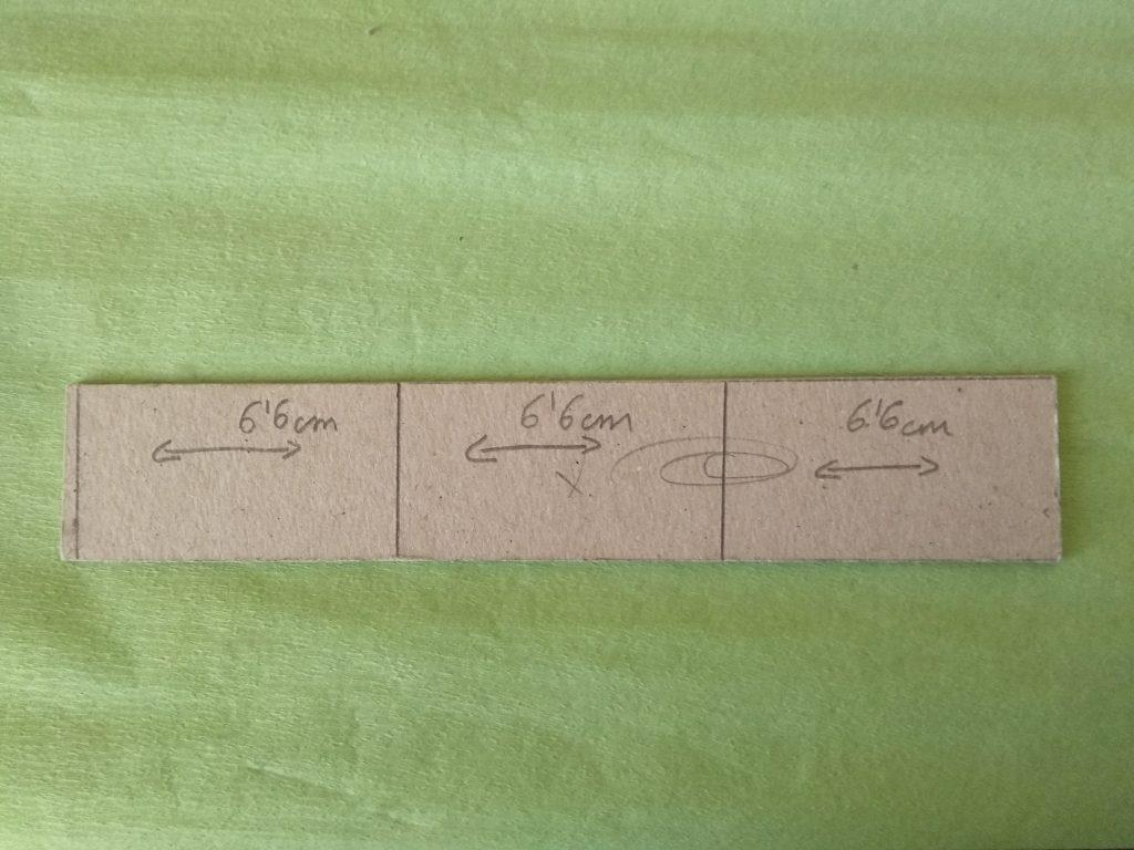 Divisor con las marcas en lápiz que indican las tres divisiones