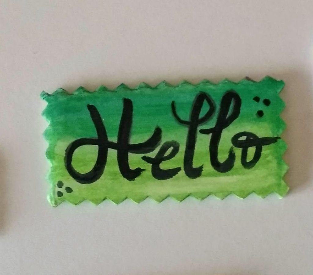 Sticker o pegatina de cartón pluma con la palabra Hello